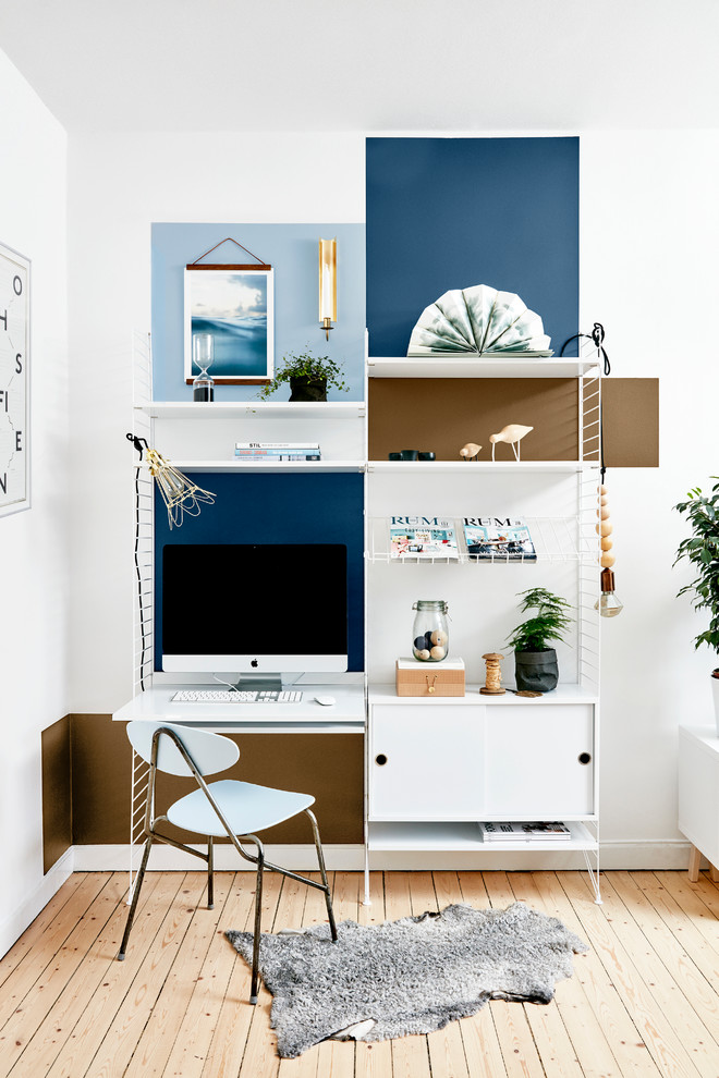 Study room - mid-sized scandinavian freestanding desk light wood floor study room idea in Other with multicolored walls and no fireplace
