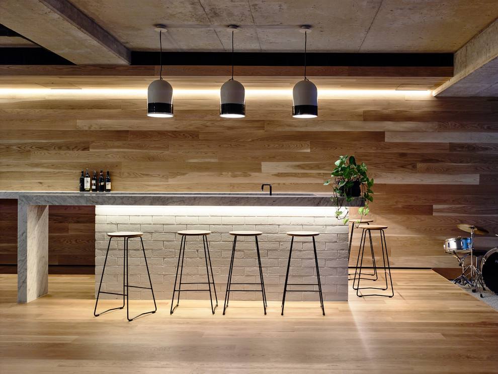 Photo of a large contemporary breakfast bar in Melbourne with marble worktops.