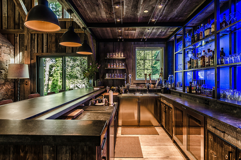 Inspiration for a large rustic u-shaped light wood floor and beige floor seated home bar remodel in New York with dark wood cabinets, an integrated sink, flat-panel cabinets, zinc countertops, black backsplash and stone slab backsplash