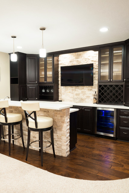 basement bar with wood flooring and stone wall - contemporary - home bar - other metro -case