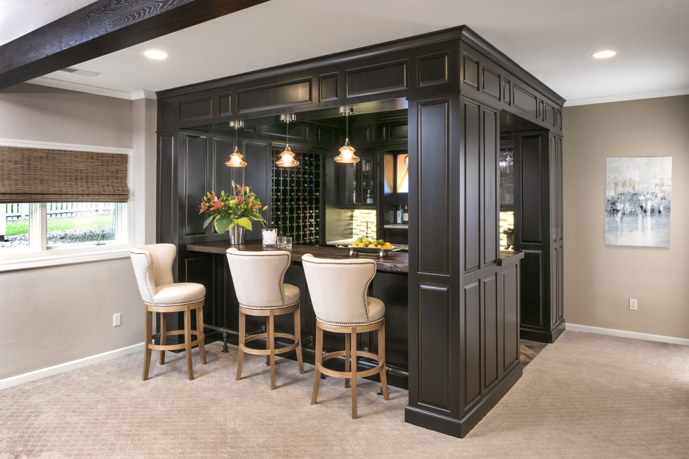 Inspiration for a large timeless u-shaped carpeted and gray floor seated home bar remodel in Minneapolis with an undermount sink, raised-panel cabinets, black cabinets, wood countertops and multicolored backsplash
