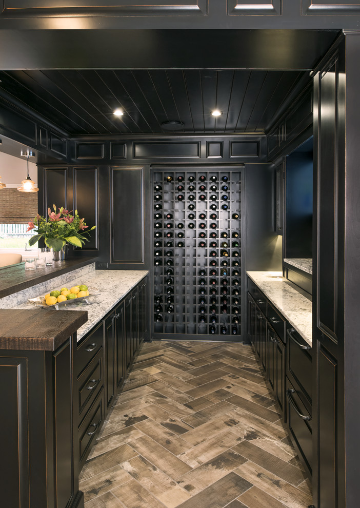Example of a large transitional u-shaped medium tone wood floor home bar design in Minneapolis with an undermount sink, raised-panel cabinets, black cabinets, wood countertops and multicolored backsplash