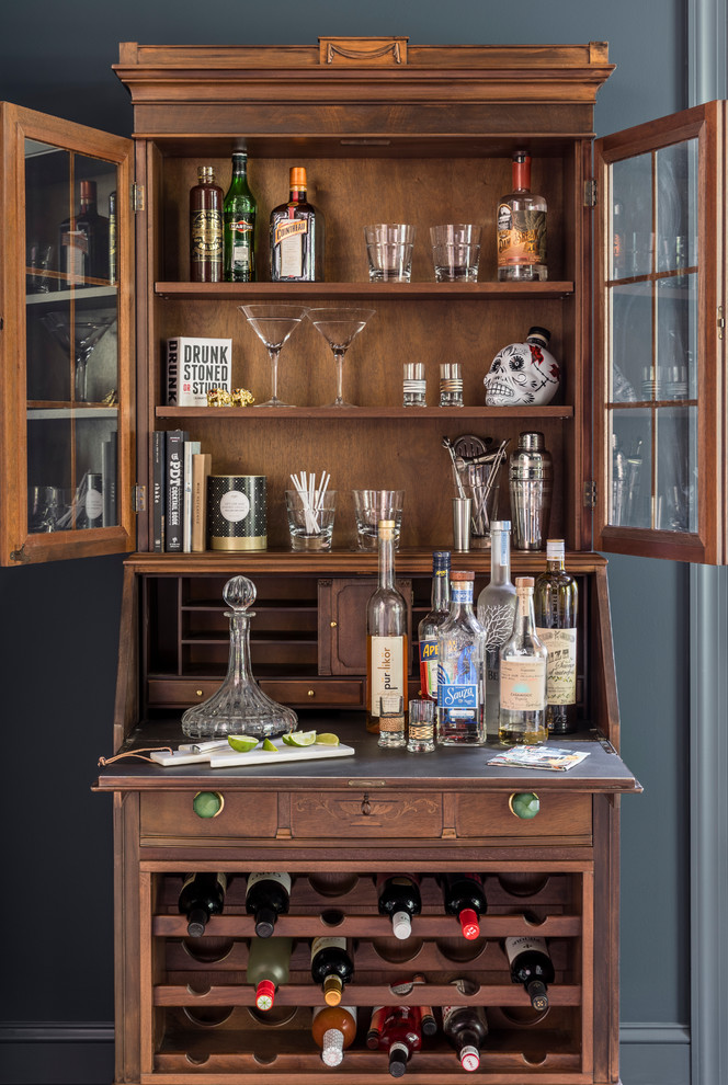 Eclectic bar cart photo in New York with dark wood cabinets