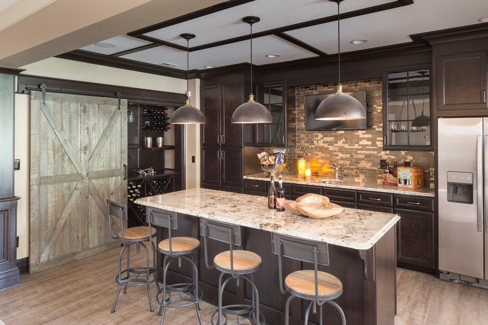 Example of a classic galley seated home bar design in Indianapolis with an undermount sink, recessed-panel cabinets, dark wood cabinets, multicolored backsplash and mosaic tile backsplash