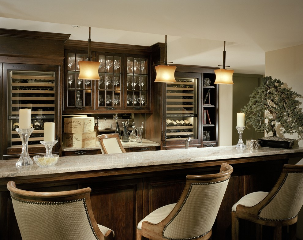 Large elegant seated home bar photo in Wilmington with glass-front cabinets, dark wood cabinets and mirror backsplash