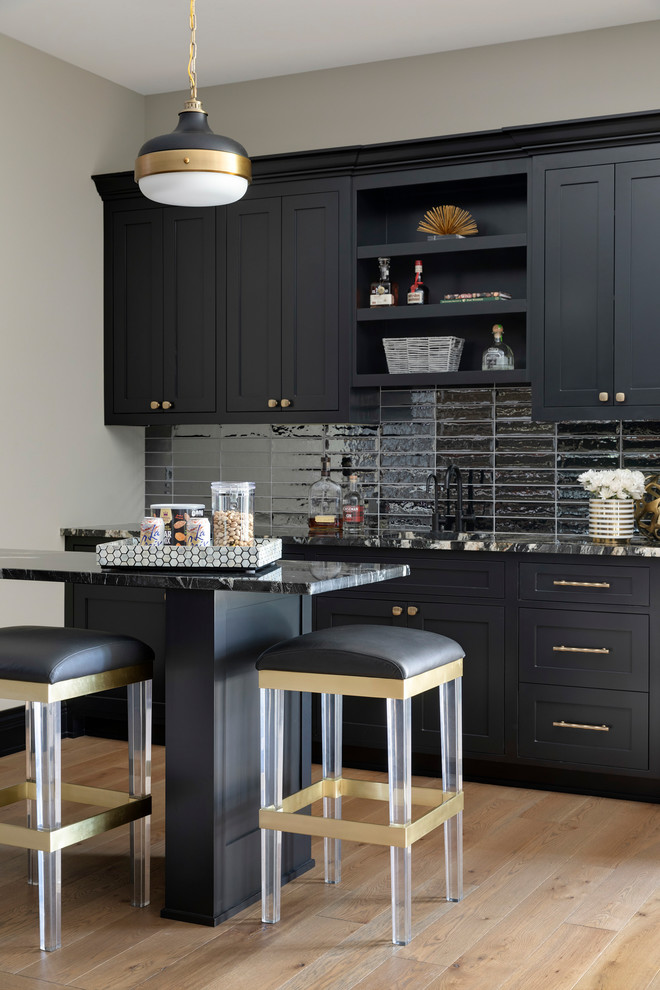 Seated home bar - mid-sized coastal beige floor and light wood floor seated home bar idea in Minneapolis with an undermount sink, black cabinets, granite countertops, black backsplash, glass tile backsplash, multicolored countertops and shaker cabinets