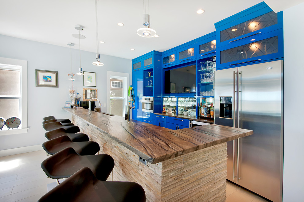 Trendy galley seated home bar photo in Other with glass-front cabinets and blue cabinets