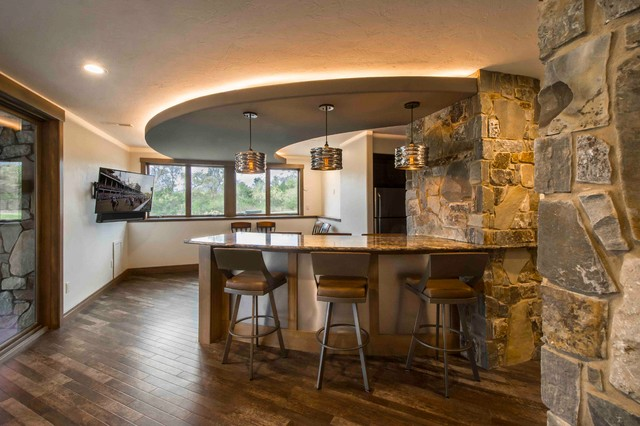 Curved Bar Seating Under Curved Soffitt With Rustic Stone