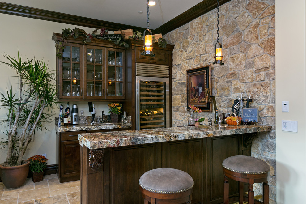 Seated home bar - traditional galley seated home bar idea in San Diego with raised-panel cabinets and dark wood cabinets