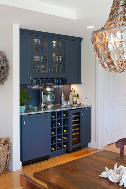 Wet bar - mid-sized contemporary single-wall light wood floor and brown floor wet bar idea in Boston with no sink, recessed-panel cabinets, blue cabinets, quartzite countertops, blue backsplash and wood backsplash