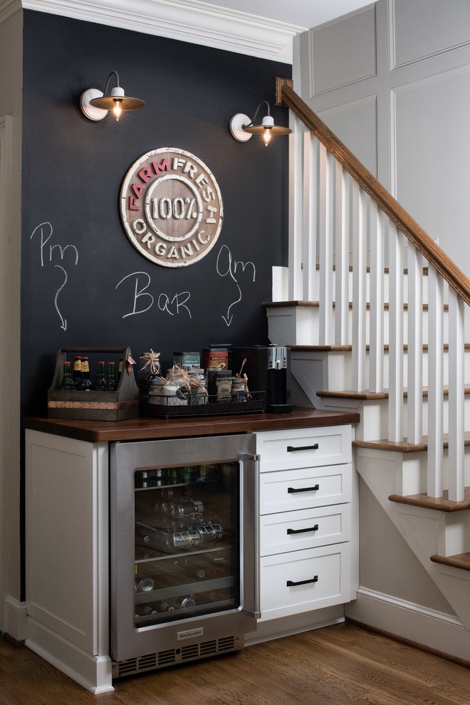 Inspiration for a small cottage single-wall dark wood floor and brown floor home bar remodel in Atlanta with shaker cabinets, white cabinets, no sink, wood countertops and brown countertops