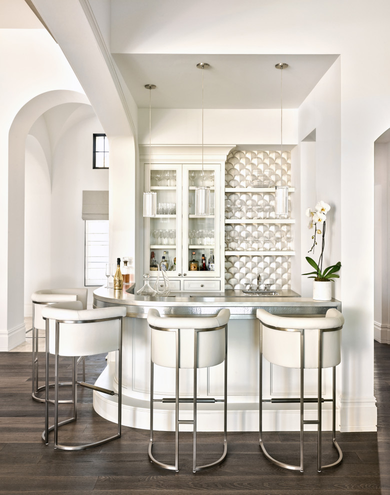 Seated home bar - mediterranean u-shaped dark wood floor and brown floor seated home bar idea in Phoenix with glass-front cabinets, white cabinets and gray countertops