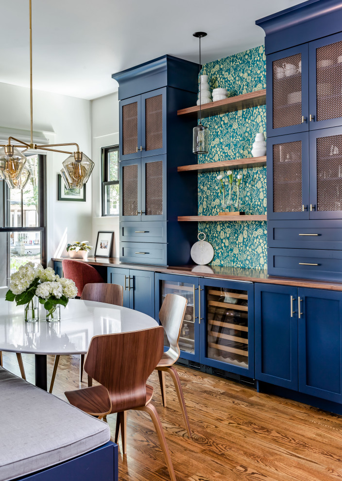Example of a transitional single-wall dark wood floor and brown floor home bar design in Atlanta with shaker cabinets, blue cabinets, wood countertops and brown countertops