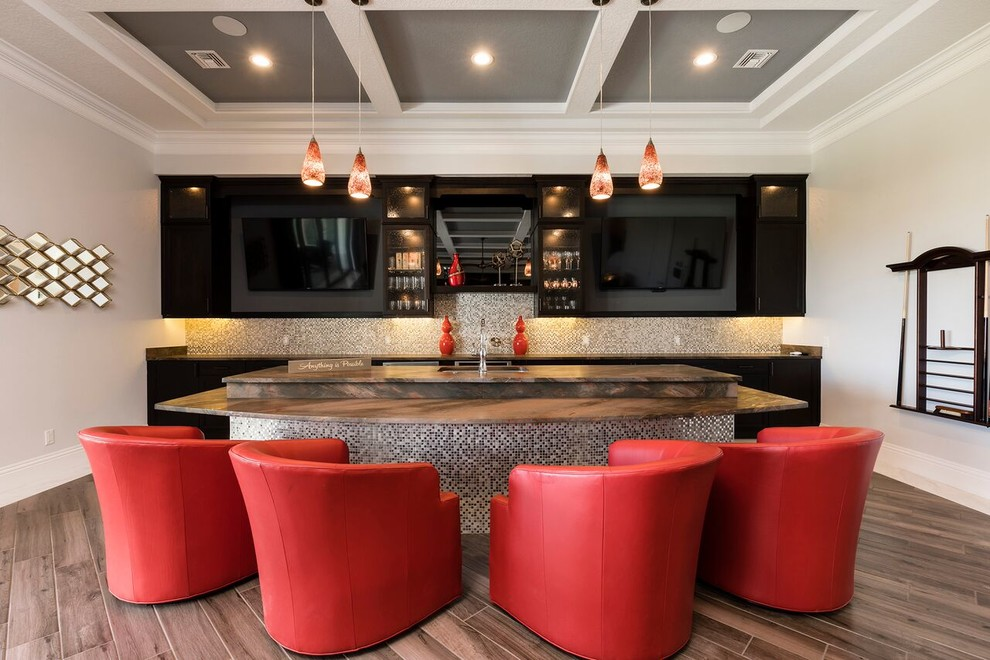 Example of a transitional home bar design in Orlando