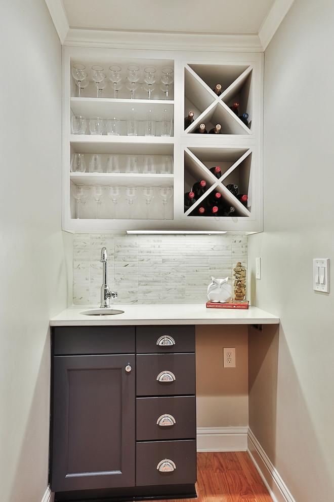 Small transitional home bar photo in Atlanta with marble backsplash