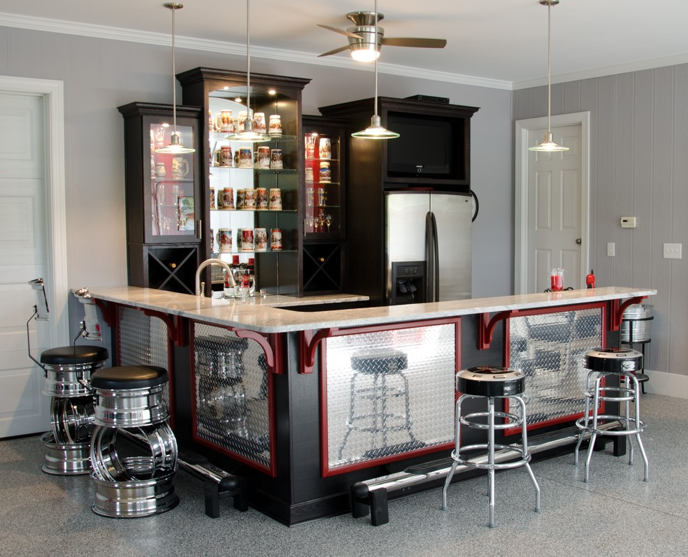 Seated home bar - traditional u-shaped gray floor seated home bar idea in Raleigh with dark wood cabinets