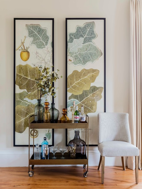Use a bar cart to decorate and fill an empty wall! See all 15 CREATIVE ways to use and style a bar cart in your home.