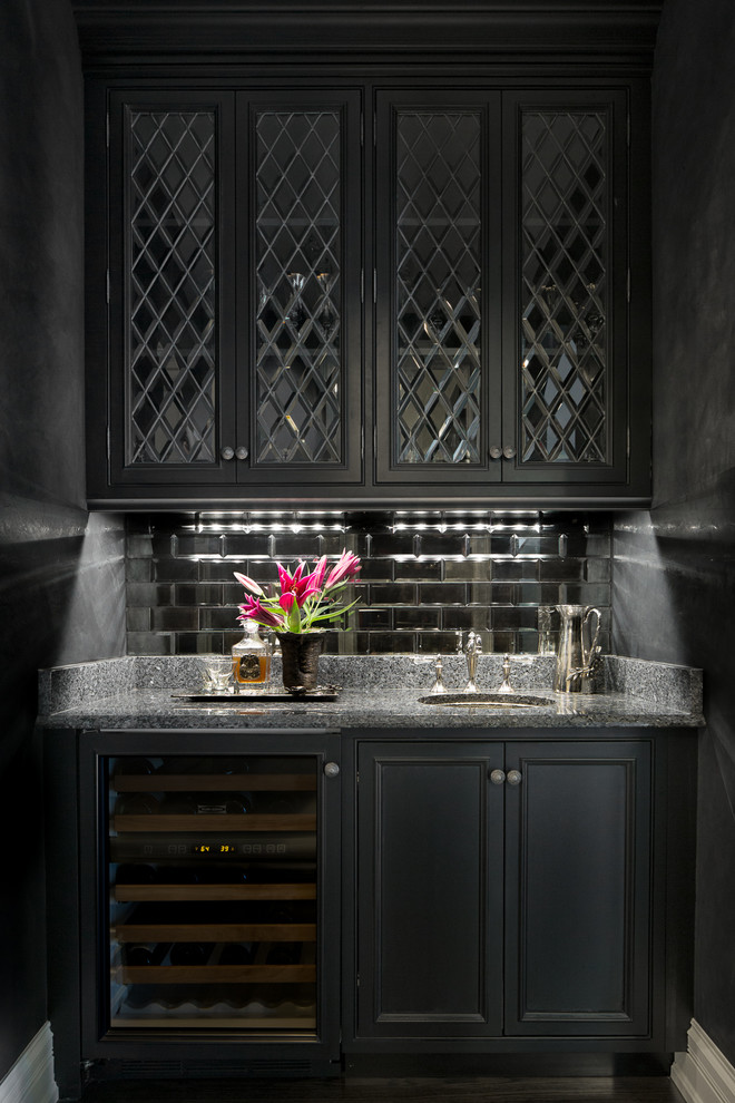 Example of a small classic wet bar design in Chicago with an undermount sink, glass-front cabinets, black cabinets and mirror backsplash