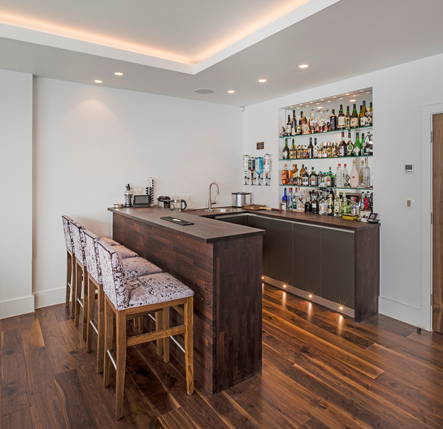 In The Corner Of The Games Family Room A Home Bar