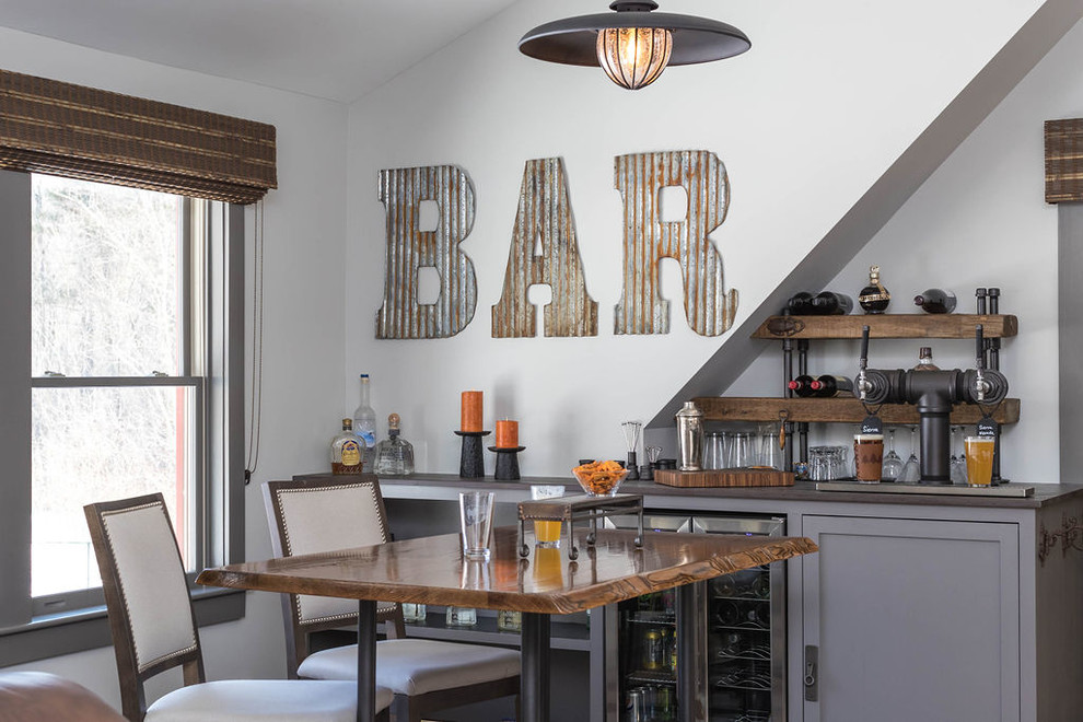 Seated home bar - large rustic single-wall seated home bar idea in Boston with shaker cabinets, gray cabinets, white backsplash and brown countertops