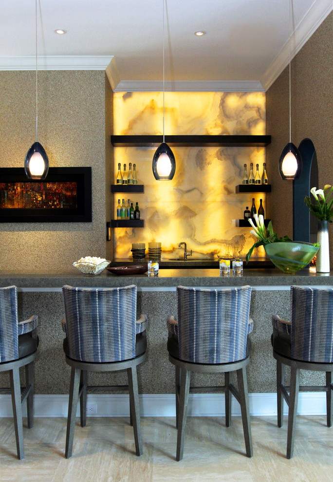 Inspiration for a contemporary galley limestone floor and beige floor seated home bar remodel in Jacksonville with yellow backsplash, stone slab backsplash, black cabinets, granite countertops and gray countertops