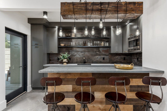 Inspiration for a large contemporary u-shaped porcelain floor and gray floor wet bar remodel in Salt Lake City with an undermount sink, flat-panel cabinets, gray cabinets, quartzite countertops, gray backsplash and gray countertops
