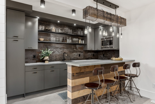 Example of a large trendy u-shaped porcelain floor and gray floor wet bar design in Salt Lake City with an undermount sink, flat-panel cabinets, gray cabinets, quartzite countertops, gray backsplash and gray countertops