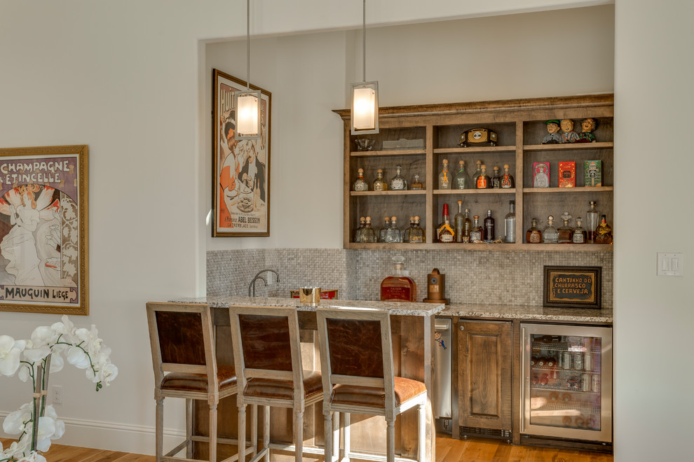 Transitional galley seated home bar photo in Dallas with raised-panel cabinets, beige backsplash and mosaic tile backsplash