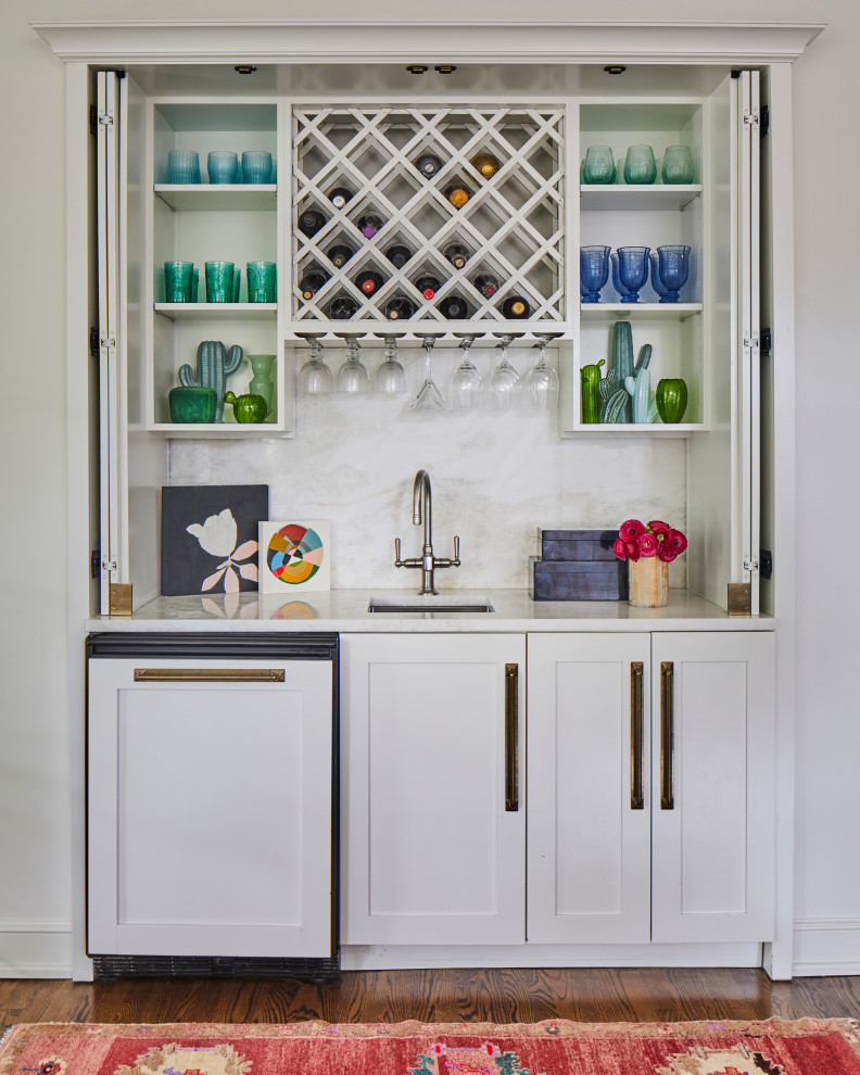 Example of a transitional home bar design in Other