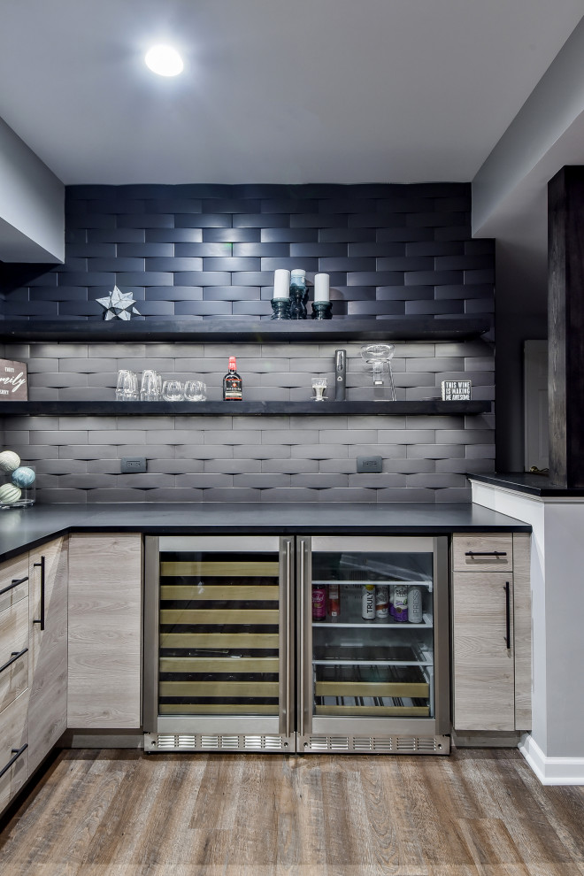 Inspiration for a contemporary l-shaped brown floor home bar remodel in Chicago with flat-panel cabinets, brown cabinets, black backsplash and black countertops