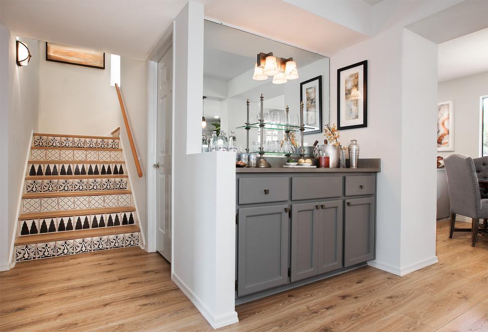 Small trendy home bar photo in Phoenix with gray cabinets, quartz countertops, gray backsplash, stone slab backsplash and recessed-panel cabinets