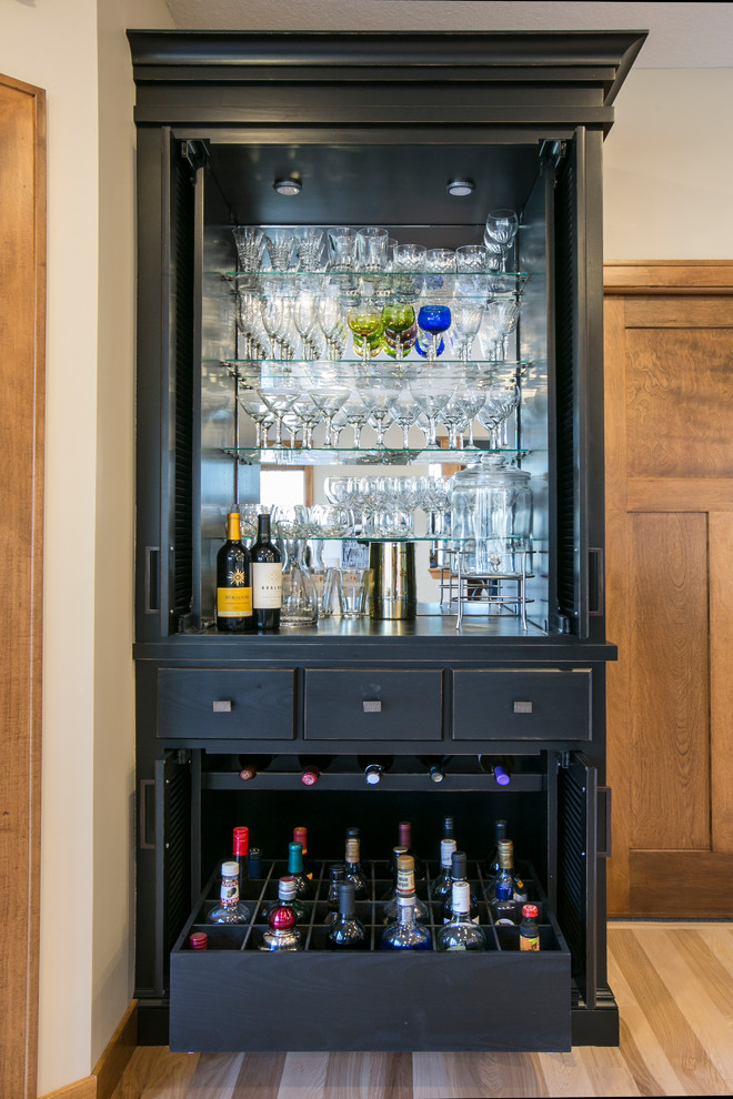 Small elegant single-wall light wood floor and beige floor home bar photo in Minneapolis with no sink and black cabinets