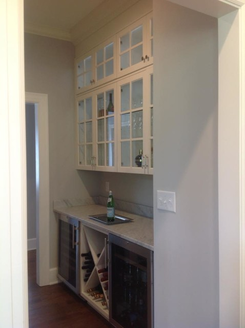 Example of a transitional home bar design in Indianapolis