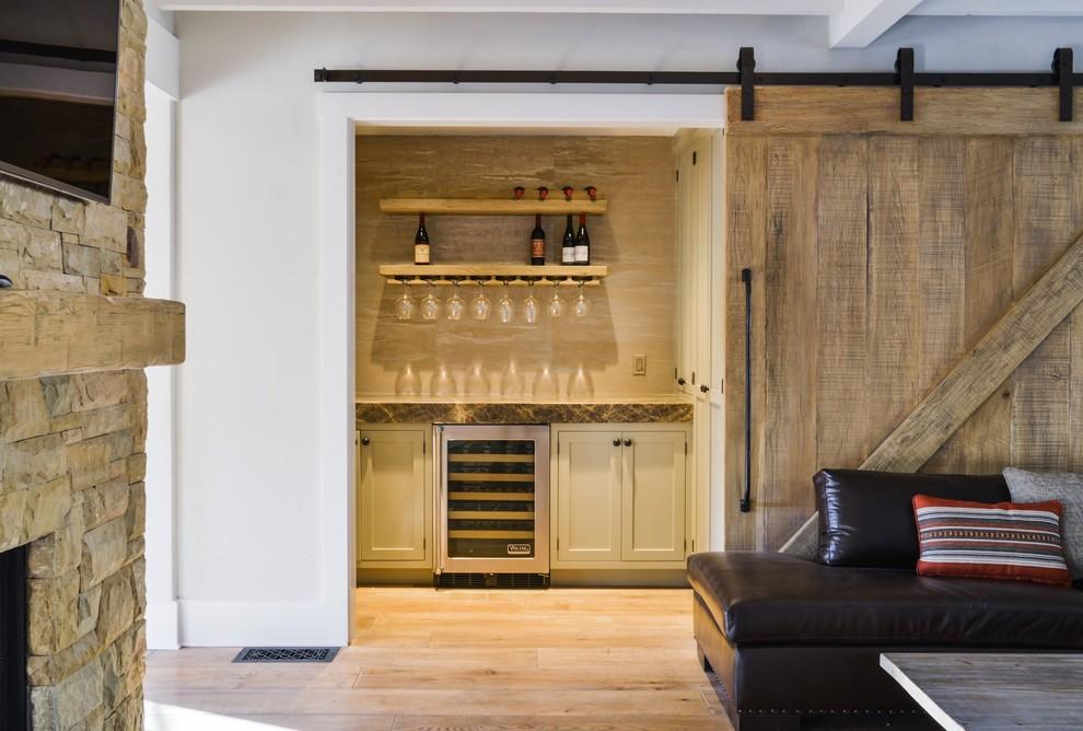 Inspiration for a farmhouse light wood floor home bar remodel in Santa Barbara