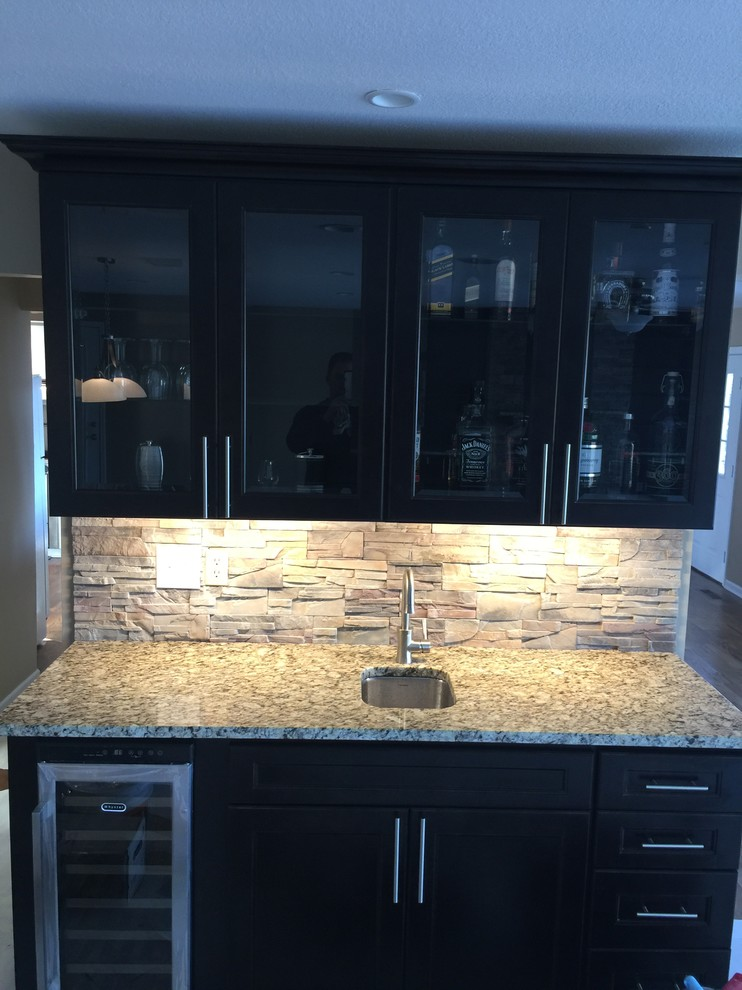 Inspiration for a small contemporary dark wood floor and brown floor wet bar remodel in Other with an undermount sink, raised-panel cabinets, white cabinets, granite countertops and multicolored backsplash