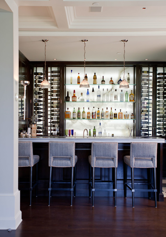 Inspiration for a transitional dark wood floor and brown floor seated home bar remodel in Los Angeles with white backsplash, stone slab backsplash and gray countertops
