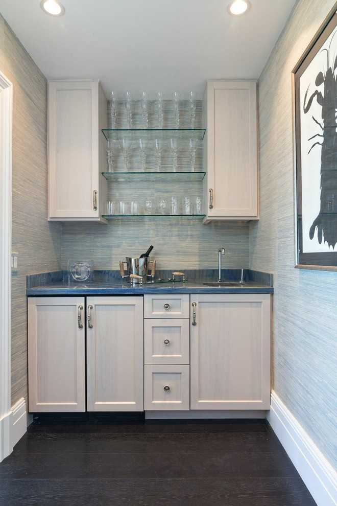 Wet bar - small transitional single-wall dark wood floor and brown floor wet bar idea in Boston with an undermount sink, shaker cabinets, light wood cabinets, granite countertops and blue countertops