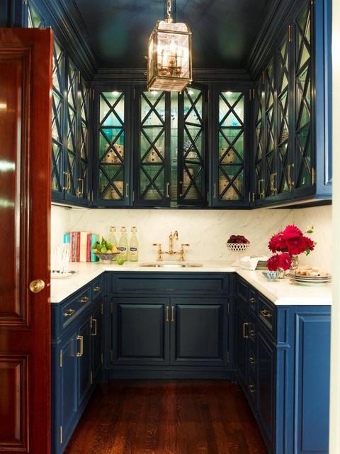 Mid-sized elegant u-shaped dark wood floor wet bar photo in New York with an undermount sink, raised-panel cabinets, white backsplash, stone slab backsplash, white countertops and blue cabinets