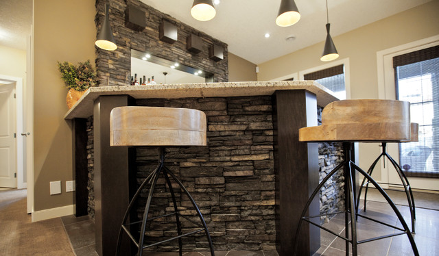 Pioneering Exquisite DesignStone basement wetbar and dark wood