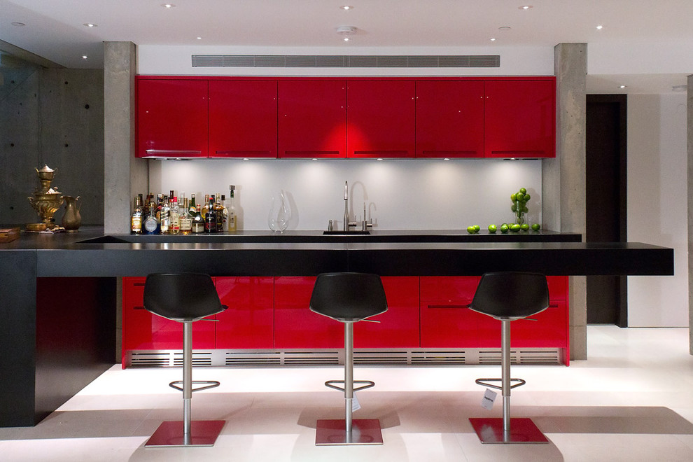 Inspiration for a mid-sized contemporary u-shaped white floor seated home bar remodel in Vancouver with flat-panel cabinets and red cabinets