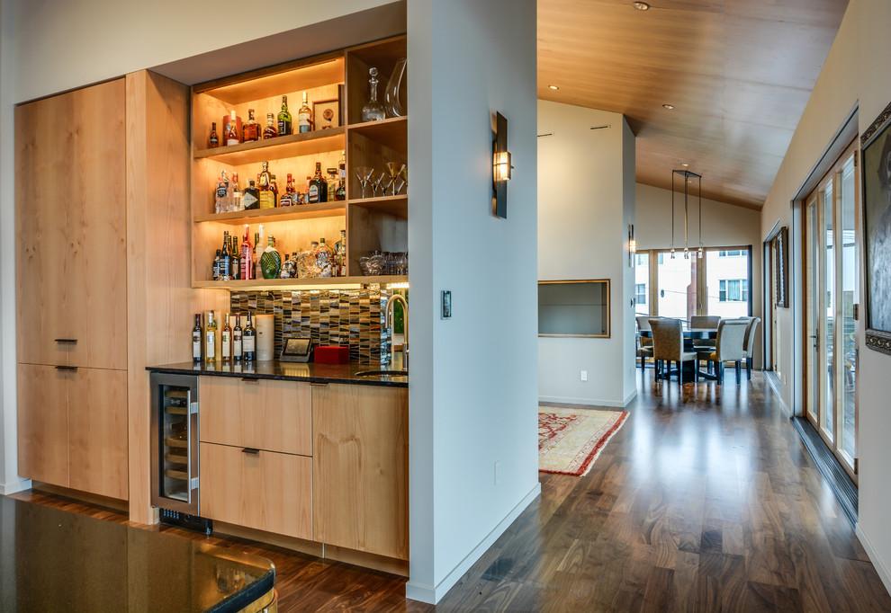 Small minimalist single-wall dark wood floor wet bar photo in Seattle with an undermount sink, flat-panel cabinets, light wood cabinets, multicolored backsplash and ceramic backsplash