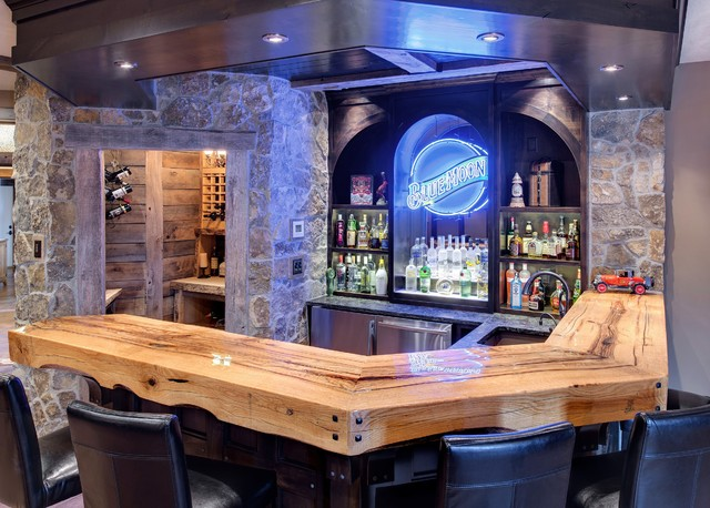 Example Of A Mountain Style U Shaped Concrete Floor Seated Home Bar Design In Minneapolis