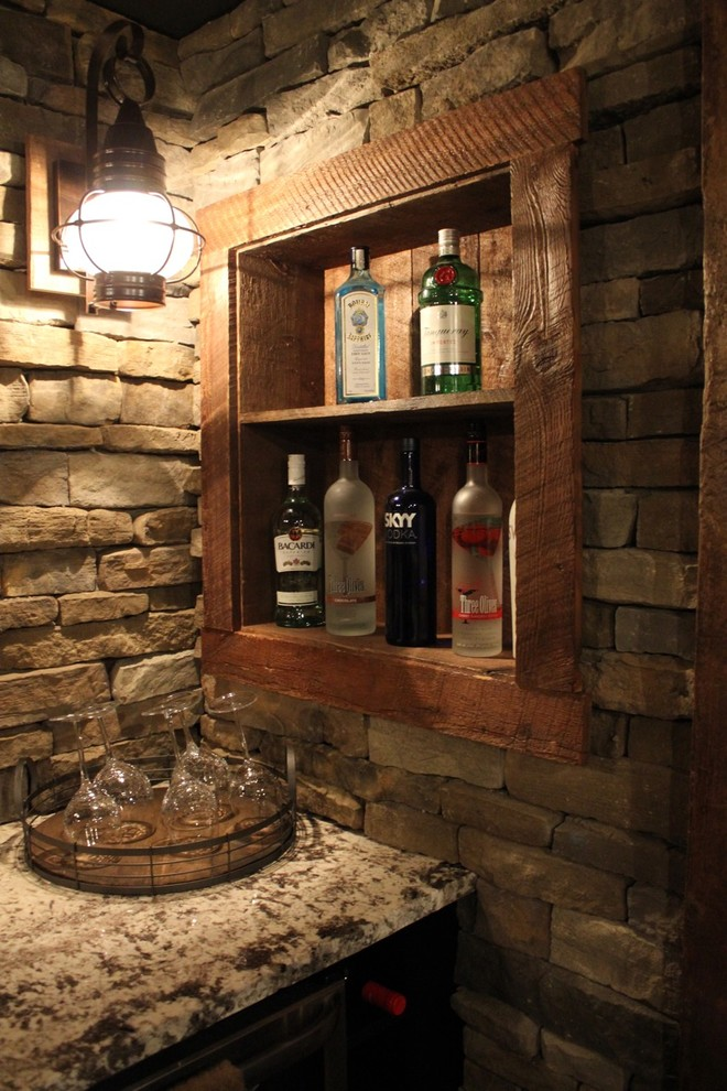 Example of a mid-sized mountain style single-wall porcelain tile and brown floor seated home bar design in Boston with an undermount sink, brown backsplash, stone tile backsplash, granite countertops and beige countertops