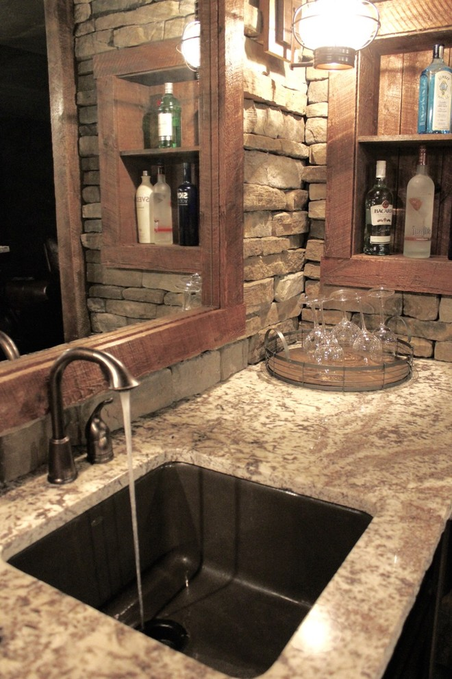 Mid-sized mountain style single-wall porcelain tile and brown floor seated home bar photo in New York with an undermount sink, brown backsplash, stone tile backsplash, granite countertops and beige countertops