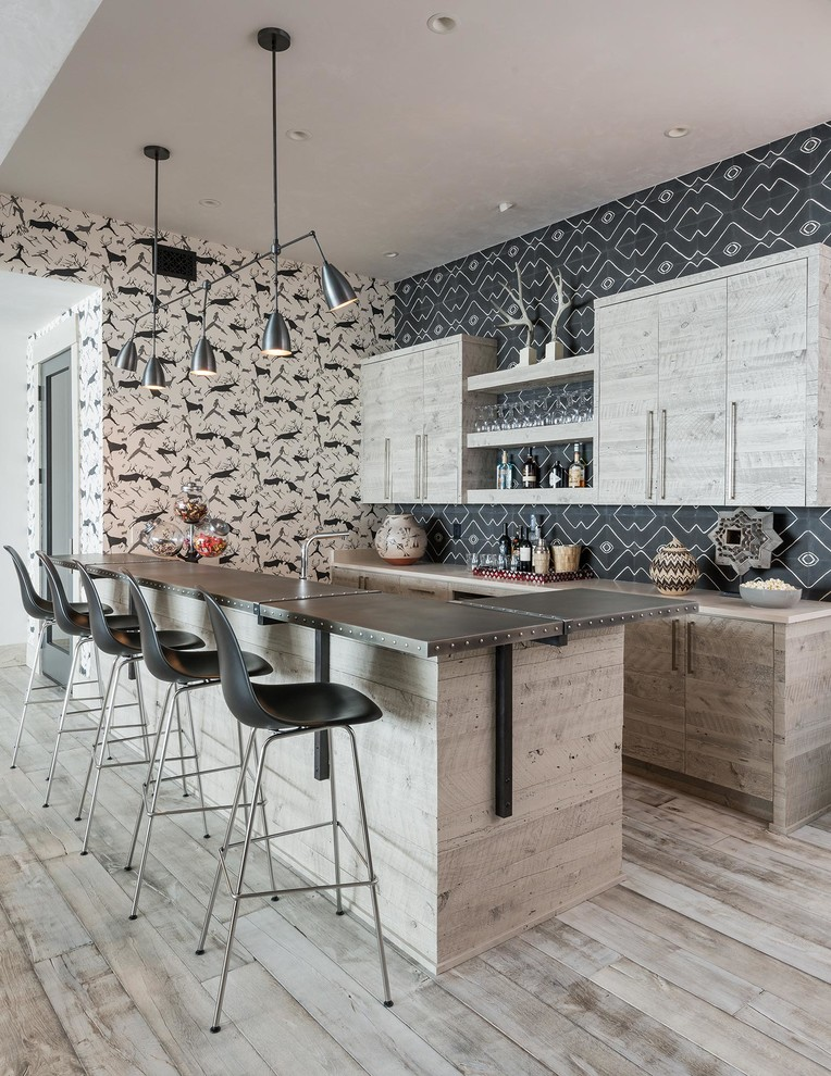Seated home bar - rustic light wood floor and beige floor seated home bar idea in Other with flat-panel cabinets, light wood cabinets and multicolored backsplash