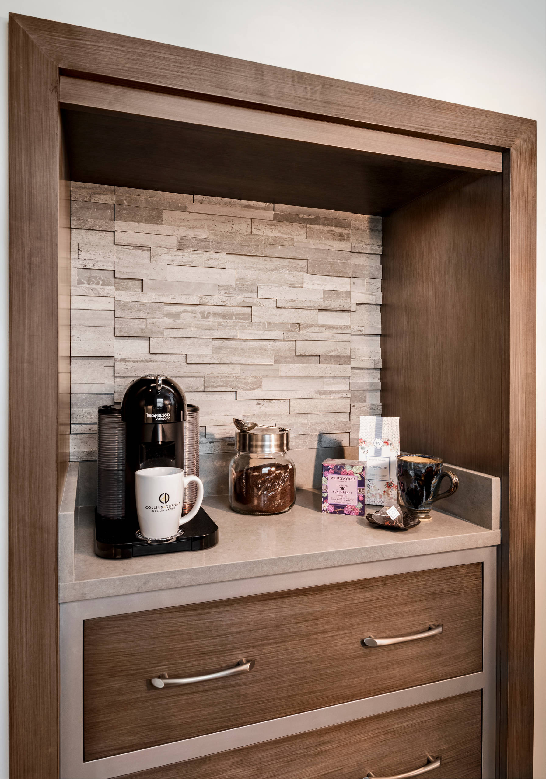 Collins & Dupont Design Group 75 beautiful home bar with brown cabinets and quartzite