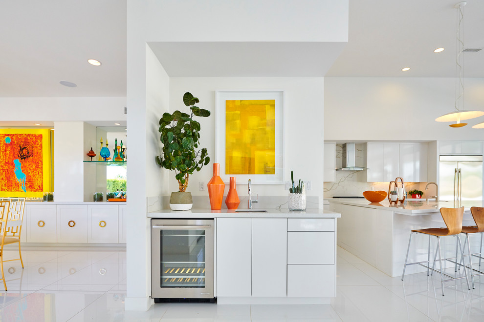 Inspiration for a small 1950s single-wall white floor wet bar remodel in Orange County with flat-panel cabinets, white cabinets, marble countertops, gray countertops and an undermount sink