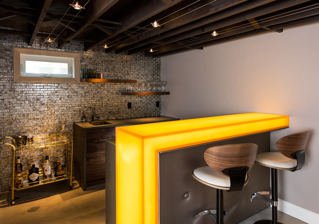Seated home bar - mid-sized contemporary concrete floor seated home bar idea in Other with gray backsplash, an undermount sink, flat-panel cabinets, dark wood cabinets, glass countertops, mosaic tile backsplash and yellow countertops