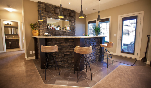 Stone Basement Wetbar And Dark Wood Cabinetry
