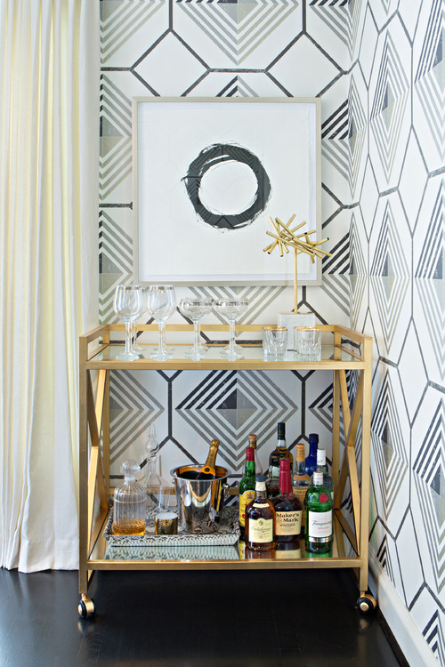 The essential stocked bar cart. Style a glam gold bar cart with abstract art and geometric wallpaper. See all 15 CREATIVE ways to use and style a bar cart in your home.